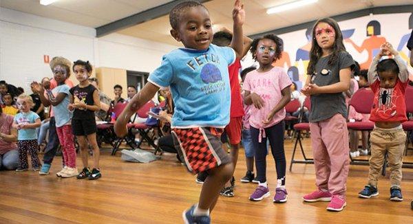 child dancing at Ethiopian LDAT event